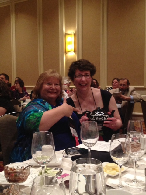 Toni LP Kelner and Dana Cameron celebrate Dana's Agatha win at Malice Domestic in Bethesda. (Photo courtesy of Dan Hale.)
