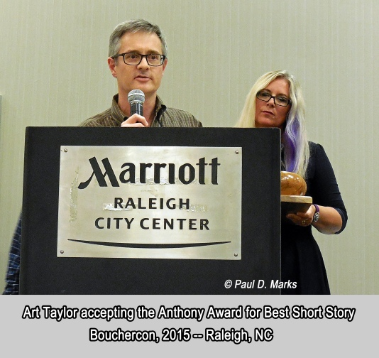 Art Taylor accepting the 2015 Anthony Award for Best Short Story. Photo courtesy of Amy Marks.